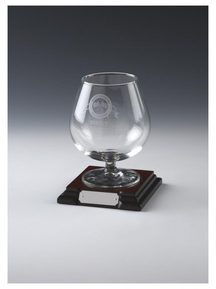 Glass Brandy Balloon On Wood Stand In Glass