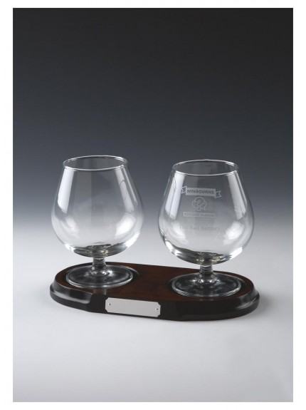 Two Glass Brandy Balloons On Wood Stand In Clear Glass