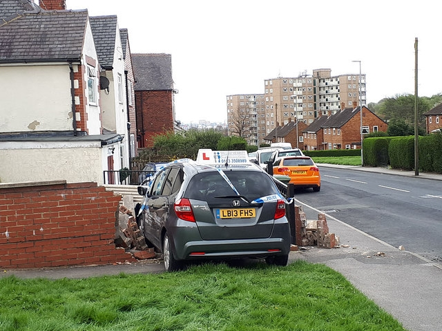 An advanced driving school car crashed into a wall