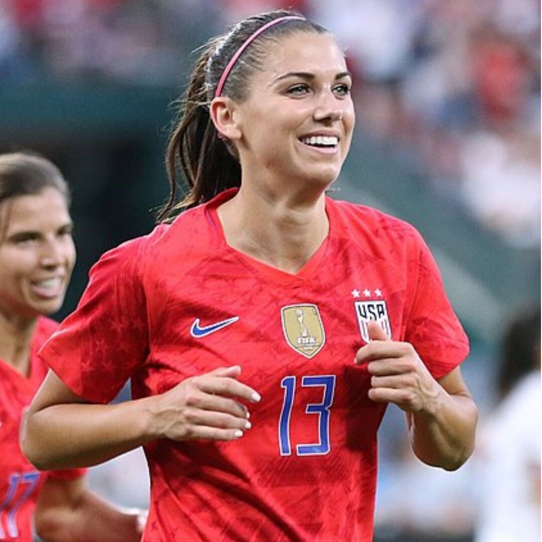 Alex Morgan Smiling in the red 2019 world cup kit