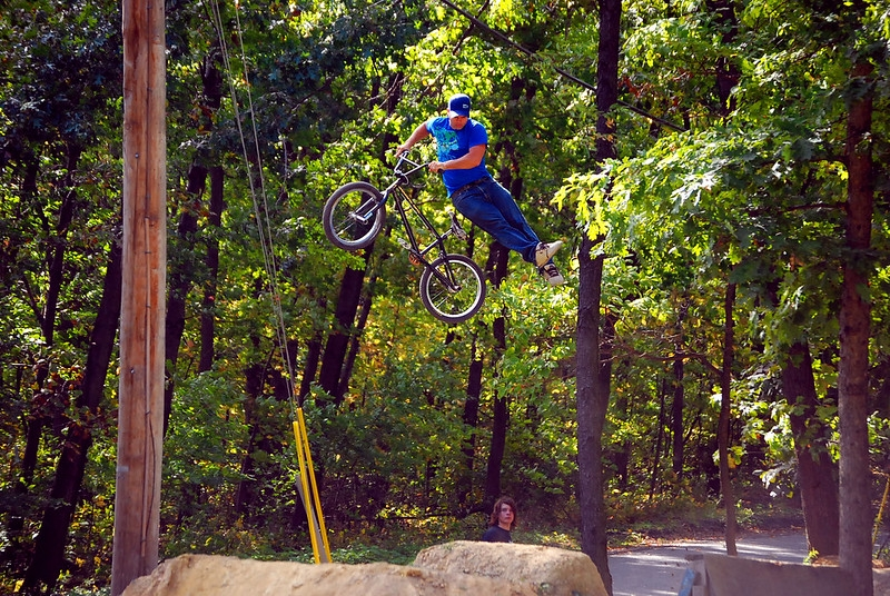 A BMX trails rider doing a no-foot can