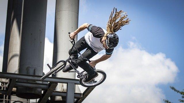 A park BMX rider doing a tuck no hander air on a quarter pipe