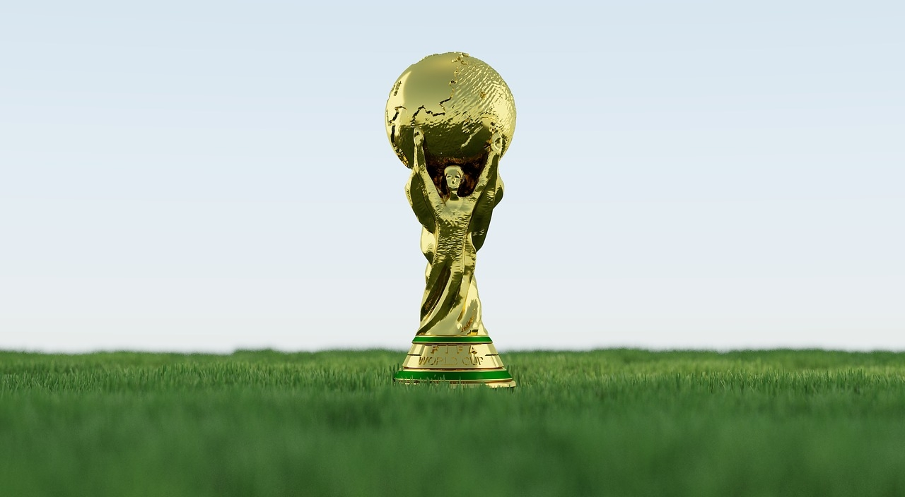 The World Cup Trophy Standing on Grass