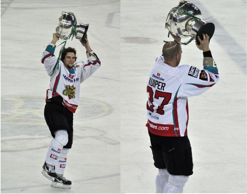 EIHL Ice Hockey Players Holding Trophies