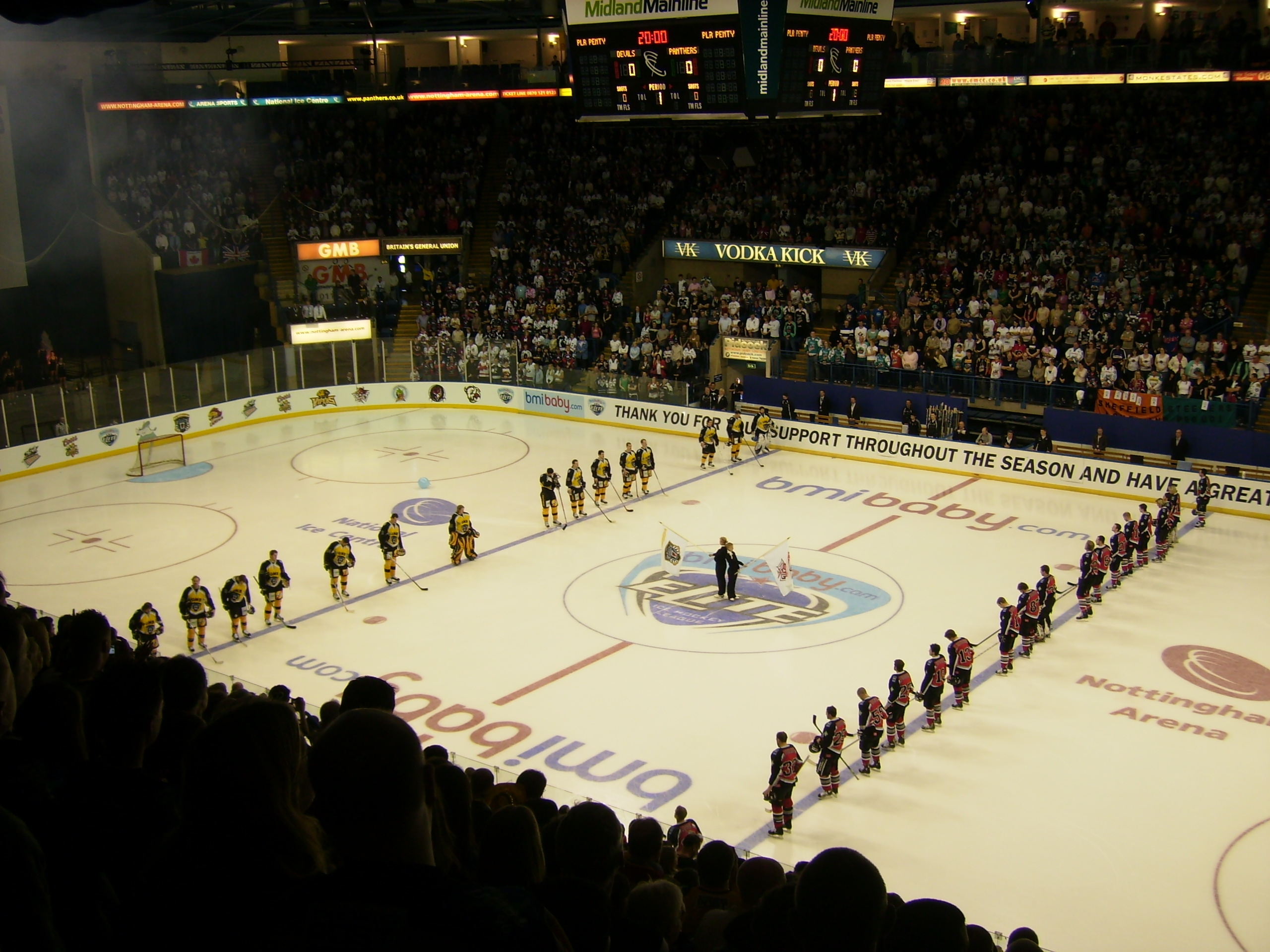 A Picture of two opposing EIHL Teams Playing Ice Hockey