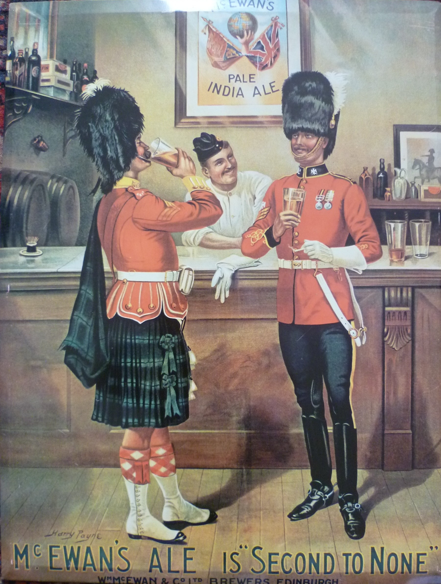 An old Ale advert featuring two British men drinking beer