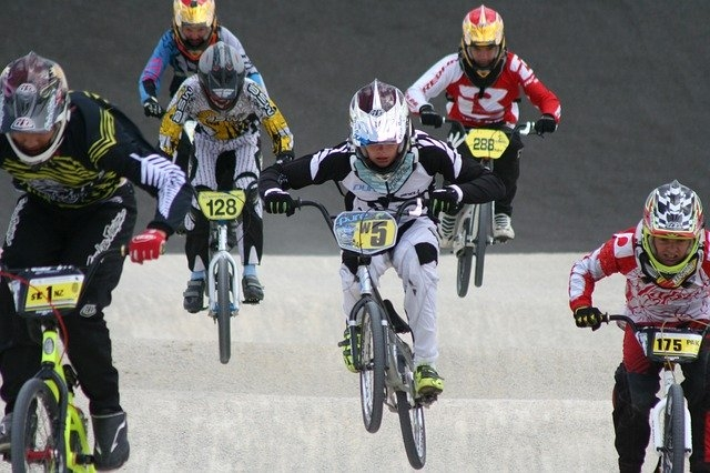 Six bicycle motocross racers racing on a bmx race track