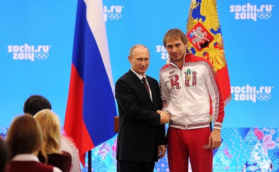 Vladimir Putin with Russian medallist