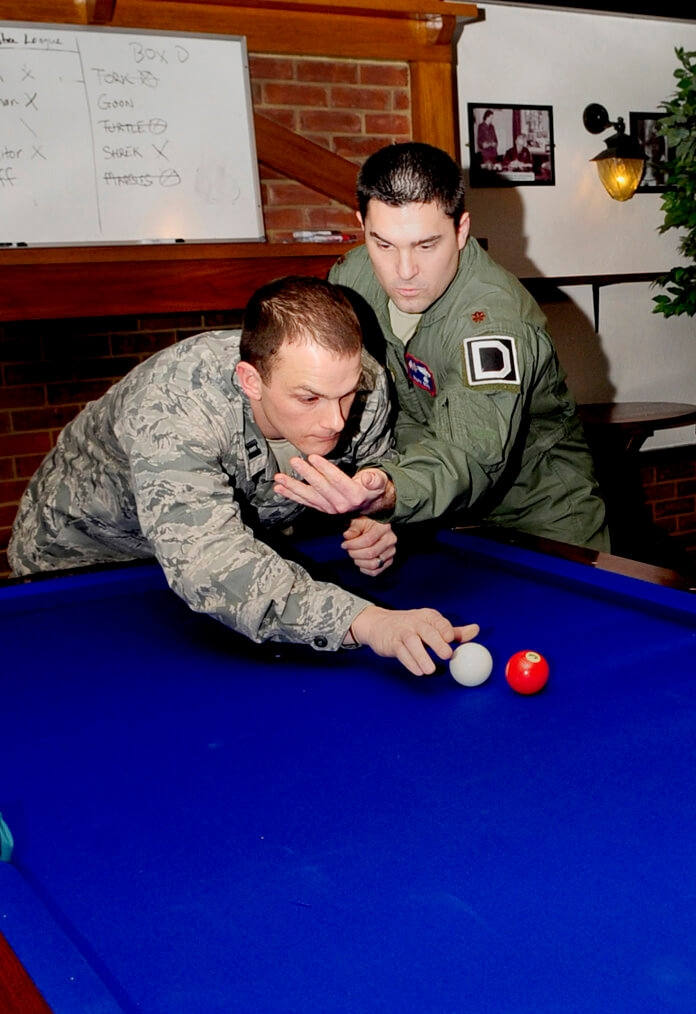 Uniformed soldiers playing pool