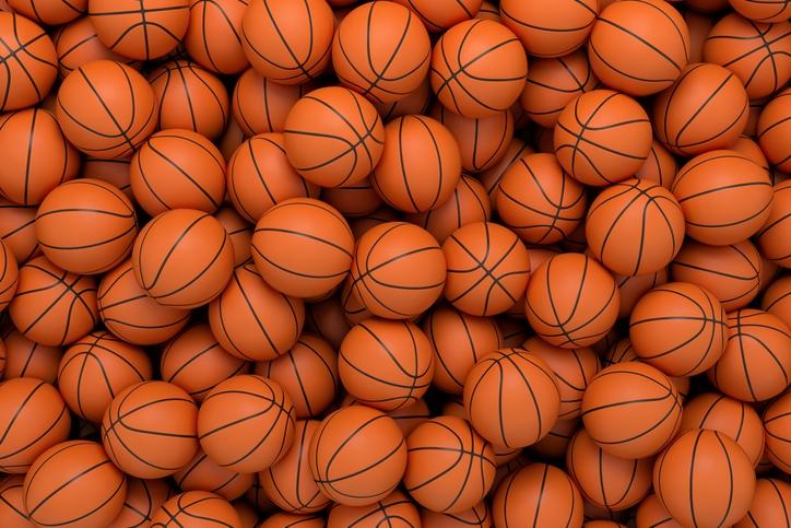 A big pile of basketballs