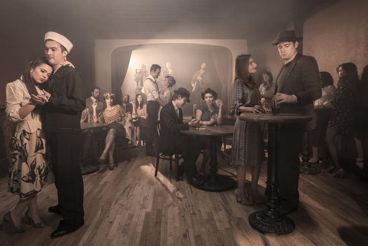 People drinking and dancing at a speakeasy