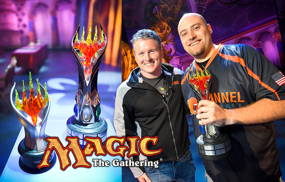 Magic the Gathering world champions standing with their trophy